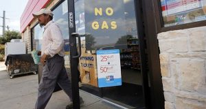 "A customer walks out of an Exxon filling station and convenience store where a sign on the door reads ""No Gas,"" Thursday, Aug. 31, 2017, in Bedford, Texas. It's getting harder to fill gas tanks in parts of Texas where some stations are out of fuel and pump costs are spiking. A major gasoline pipeline shuttered due to Harvey may be able to resume shipping fuel from the Houston area by Sunday, which could ease gasoline shortages across the southern U.S. (AP Photo/Tony Gutierrez)"
