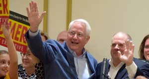 Al Redmer and waving to a crowd with Governor Larry Hogan at a Redmer for Baltimore County Executive rally on Sept. 23, 2017. (The Daily Record / Bryan P. Sears.)