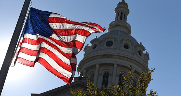 Flags flew at half staff outside of city hall in Baltimore in morning for at least 58 lives taken and hundreds injured by Steven Paddock at the country music festival around 10pm on Sunday in Las Vegas. It was the deadliest mass shooting in modern US history. (The Daily Record/Maximilian Franz)