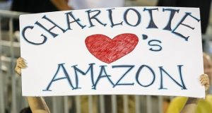 A Carolina Panther fan shows his desire for Amazon to make Charlotte it's East Coast headquarters before an NFL football game against the Philadelphia Eagles in Charlotte, N.C., Thursday, Oct. 12, 2017. The Eagles won 28-23. (AP Photo/Bob Leverone)