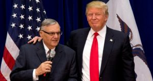 Republican presidential candidate Donald Trump is joined by Joe Arpaio, then sheriff of metro Phoenix, at a campaign event in Marshalltown, Iowa in January 2016. A federal judge Wednesday rejected challenges to President Donald Trump's pardons of Arpaio in the ex-sheriff's criminal cases but did not immediately rule on a request to vacate all of the orders in the criminal case. (Mary Altaffer/AP file photo)