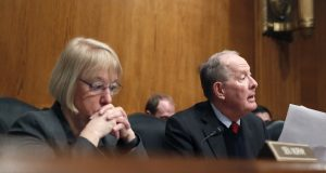 FILE- In this Jan. 31, 2017, file photo, Senate Health, Education, Labor, and Pensions Committee Chairman Sen. Lamar Alexander, R-Tenn., accompanied by the committee's ranking member Sen. Patty Murray, D-Wash. speaks on Capitol Hill in Washington during the committee's executive session to discuss the nomination of Education Secretary Betsy DeVos. Congress is at a crossroads after Senate GOP leaders announced on Tuesday, Sept. 26, that they would not take their latest repeal of Barack Obama's health care law bill to the floor for lack of support. Alexander said he would resume efforts to reach a bipartisan deal with Murray to stabilize markets for individual insurance policies that 18 million people rely on. (AP Photo/Alex Brandon, File)