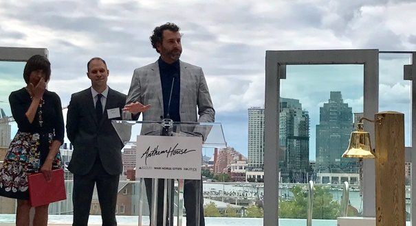 Scott Plank, founder of War Horse Cities, speaks during the ceremonial opening of the Anthem House apartments in Baltimore's Locust Point neighborhood.