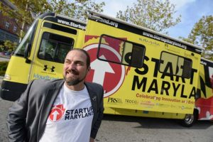 9-21-16 BALTIMORE, MD- Mike Binko standing next to the Startup Maryland Bus during its tour stop at Universty of Baltimore. (The Daily Record/Maximilian Franz)