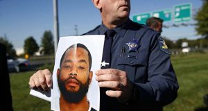 Harford County Sheriff Jeffrey Gahler displays a photo of Radee Labeeb Prince, the suspect in a shooting at a business park in the Edgewood area of Harford County, Md., Wednesday, Oct. 18, 2017. Prince killed several co-workers and wounded others before fleeing the scene, Gahler said. (AP Photo/Patrick Semansky)