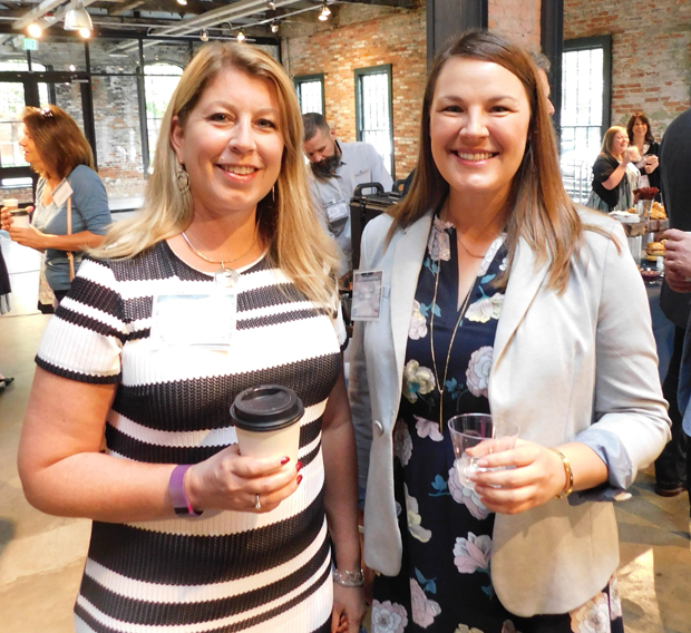 Jen Strobel, left, the vice president of human resources at Flagger Force, and Renee Evans, the human resources manager at Pompeian Inc., enjoy their time at the SC&H Group-sponsored panel discussion on manufacturing. (Photo courtesy of SC&H Group)