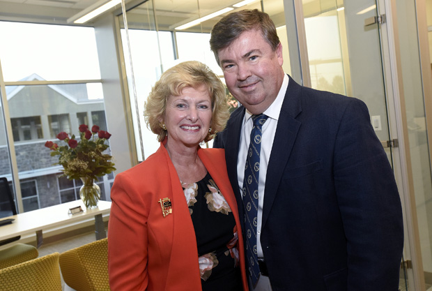 David McCollough, right, a full-time sales agent and Realtor with the Creig Northrop Team of Long & Foster Real Estate attended grand opening of the group's new offices with his wife, Cheri McCollough. (Photo by Steve Ruark)