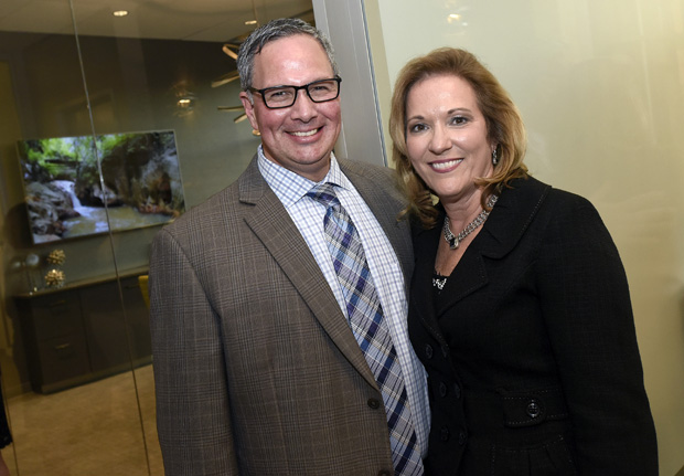 Carla Northrop, right, the vice president and CEO of Creig Northrop Team of Long & Foster Real Estate, poses for a photo with Thom Maytas, an account executive with WBFF-TV Fox45 during the team's grand-opening celebration of its new offices in Clarksville. (Photo by Steve Ruark)