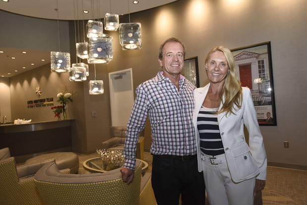Lena Munther-Andersen, right, the owner of Munther Design attended the grand-opening celebration of  new offices for the Creig Northrop Team of Long & Foster Real Estate with her husband, Espen Andersen. (Photo by Steve Ruark)