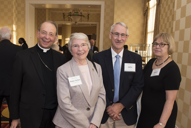 From left, Archbishop William E. Lori, of the Archdiocese of Baltimore; Sister Helen Amos, executive chair of the Mercy Medical Center Board of Trusteesl; John O'Hara, a Cristo Rey Jesuit volunteer; and Carol Baumerich, an administrative law judge with the US Occupational Safety & Health Review Commission. (Photo by Larry Canner)