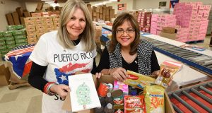 "Baltimore based entrepreneurs and Puerto Rican natives Diana Torruella Gaines of Tu Casa Development Group, Left, and Elda M. Devarie, President and CEO of EMD Sales, Inc have teamed up to ship about 450,000 pounds of donated goods to Puerto Rico since Hurricane Maria's devastation back in September. Their current effort is to ship 1,500 holiday care packages through the EMD Sales annual ""Bags of Love"" program to Puerto Rican families by Christmas. The 25-pound packages will consist of a meal to feed a family of 8 to be cooked over an outdoor fire, fresh water, a board game, candy, and a handmade Christmas card made by local elementary school students. The boxes will be assembled from 10 a.m. to 2 p.m. Dec. 2 at EMD Sales, Inc. at 2010 Washington Boulevard. Volunteers are welcome. More volunteer and donation information can be found by calling 301-322-4503, ext. 113. (The Daily Record/Maximilian Franz)"