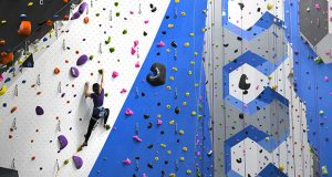 Earth Treks is celebrating its 20th anniversary in Columbia by adding a new 42,000 foot faculty with 400 new climbing and bouldering routes, seen here being tested by Charlotte Bosley, VP of Retail & Brand. The new space is located at 7125 Columbia Gateway Drrive, suite 110, in the same complex as the original space, and is set to open to the public sometime in the next few weeks. (The Daily Record / Maximilian Franz)
