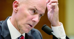 Former chairman and CEO of Equifax Richard F. Smith, scratches his head as he testifies before the Digital Commerce and Consumer Protection Subcommittee of the House Commerce Committee on Capitol Hill in Washington, Tuesday, Oct. 3, 2017. AP Photo/Carolyn Kaster)