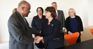 University of Baltimore President Kurt Schmoke shakes hands with Notre Dame of Maryland University President Dr. Marylou Yam on Monday after signing the matriculation agreement between the law school and Notre Dame. Looking on are, from left, Notre Dame Dean of Arts, Sciences, and Business Debra Franklin; Notre Dame Provost Clarenda Phillips; University of Baltimore School of Law Dean Ronald Weich; and University of Baltimore Executive Vice President and Provost Darlene Smith. (Maximilian Franz/The Daily Record)