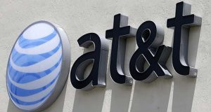 "FILE - This Thursday, July 27, 2017, file photo shows an AT&T logo at a store in Hialeah, Fla. AT&T now says it's ""uncertain"" when its $85 billion Time Warner purchase will close. AT&T had maintained that the deal would be done by the end of 2017. (AP Photo/Alan Diaz, File)"