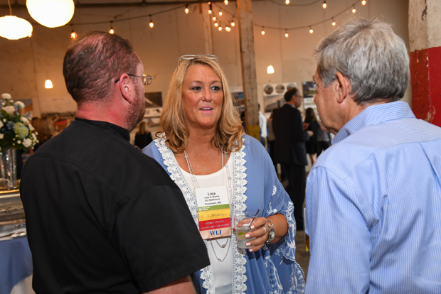 Lisa Norris, center, the Urban Land Institute's Baltimore District council coordinator, talks with David Tafaro, left, of Terranova Development, and Raoul Frevel of Atlantic Catering during the ninth annual ULI WaveMaker Awards. (Photo by Maximilian Franz)