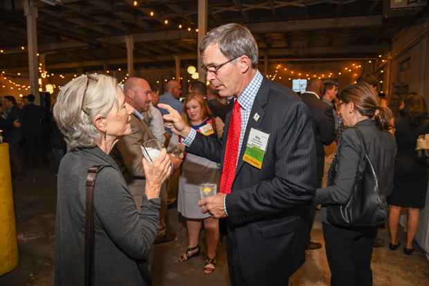 Willy Moore, right, the president of Southway Builders, chats with Polly Duke, the senior vice president for construction and design with Homes for America, as they socialize during the ninth annual Urban Land Institute WaveMaker Awards. (Photo by Maximilian Franz)