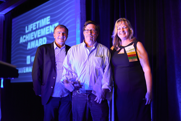 Bill Struever, center, one of the founders of Cross Street Partners, accepts the Lifetime Achievement Award, presented by Kim Clark, right, the executive vice president of the Baltimore Development Corporation and the Baltimore District Council chair for the Urban Land Institute, and Stanley Fine, a partner with Rosenberg Martin Greenberg and the 2016 winner of the award, during the ninth annual Urban Land Institute WaveMaker Awards. (Photo by Maximilian Franz)