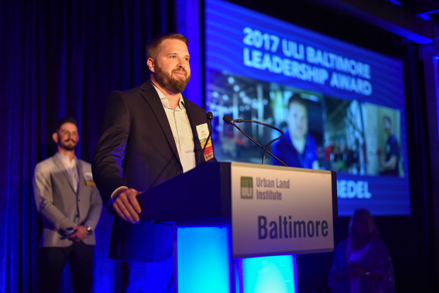 Josh Halbedel of EA Realty accepts the 2017 Leadership Award during the ninth annual Urban Land Institute WaveMaker Awards, which was presented by last year's winner, Kristian Spannhake of Shelter Development. (Photo by Maximilian Franz)