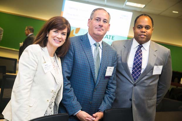 Kelly Hodge-Williams, far left, the president and CEO of Business Volunteers Maryland, get a photos with John Hoey, the president and CEO of The Y of Central Maryland and a BVMD board member, as well as Eric Sommerville, the executive director of volunteerism and community engagement wth The Y of Central Maryland at the inaugural Business Impact Summit. (Photo courtesy of Business Volunteers Maryland)