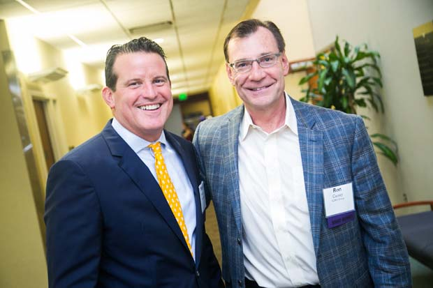 Mark Mullican, left, the president and CEO of The Columbia Bank, caught up with Ron Causey, the CEO of SC&H Group, during the its inaugural Business Impact Summit. Mullican was also a featured speaker at the event. (Photo courtesy of Business Volunteers Maryland)