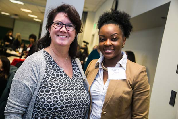 Bolton Partners' colleagues Agatha Arlington, left, the director of administrative services, and Erryn Claxton, a technical administrative assistant, enjoy their time at the inaugural Business Impact Summit. (Photo courtesy of Business Volunteers Maryland)