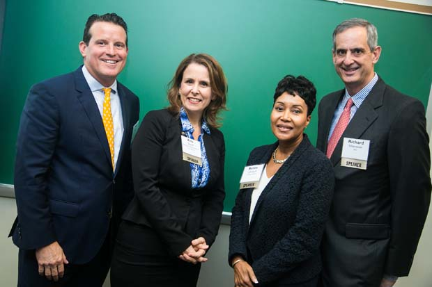 Mark Mullican, left, the president and CEO of The Columbia Bank and a featured speaker at the event; Kristen Shock, the senior director of office of strategic industries and entrepreneurship with the Maryland Department of Commerce; Renee Christoff, a vice president with T. Rowe Price Group; and Richard Silberstein, president of Silberstein Insurance Group, take time for a photo during the inaugural Business Impact Summit. (Photo courtesy of Business Volunteers Maryland)