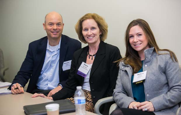 T. Rowe Price Group colleagues Kevin Shea, a senior manager in the firm's corporate social responsibility group; Stacey Horn, executive director of the T. Rowe Price Foundation; and Melissa Cheek, a senior corporate social responsibility consultant, enjoy their time at the inaugural Business Impact Summit. (Photo courtesy of Business Volunteers Maryland)