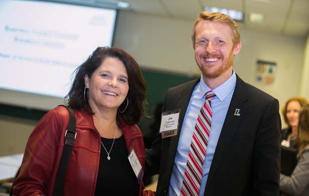 Bradie Barr, left, the president of Transamerica and a Business Volunteers Maryland board member, meets up with Jim Dickinson, the assistant vice president for career services with Loyola University Maryland, during the inaugural Business Impact Summit. (Photo courtesy of Business Volunteers Maryland)