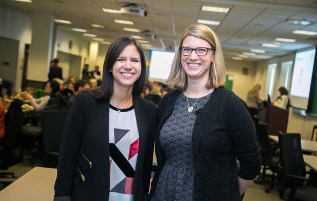 Jess Oring, left, a public relations and social media manger with Medifast Inc.; poses for a photo with Stephanie Baker, a program manager with Northop Grumman during the inaugural Business Impact Summit. Both Oring and Baker are 2017 Business Volunteers GIVE alumni. (Photo courtesy of Business Volunteers Maryland)