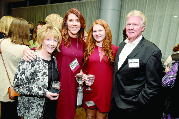 "From left, Susan Wollenweber; Casey Baynes, the founder of the Casey Cares Foundation and a Most Admired CEO award winner; Baynes' daughter, Makenzie Baynes; and Charles ""Charlie"" Wollenweber IV, the president of Wollenweber's Trucking and Warehousing take time for a photo during The Daily Record's 2017 Most Admired CEOs celebration. (Photo by Maximilian Franz)"