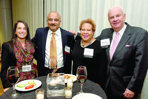 From left, Shirley Mowery, a business development director with Hertzbach & Co.; John Hamilton, the president and CEO of MECU of Baltimore and a Most Admired CEO award winner; Lyn Farrow, vice president for development and public policy with Goodwill Industries of the Chesapeake; and Bob Kimmons, a director with Goodwill Industries of the Chesapeake Inc., take time for a photo during The Daily Record's 2017 Most Admired CEOs celebration. (Photo by Maximilian Franz)