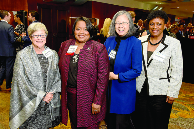 From left Deborah Diehl, a partner with the law firm Whiteford, Taylor and Preson; Violet Apple, the CEO of Girl Scouts of Maryland and a Most Admired CEO award winner; Mariah Hwang, a principal with the law firm Miles & Stockbridge P.C.; and Gwendolyn Skillern, senior vice president and general auditor with CareFirst BlueCross BlueShield, enjoy the evening at the BWI Hilton for The Daily Record's 2017 Most Admired CEOs celebration. (Photo by Maximilian Franz)