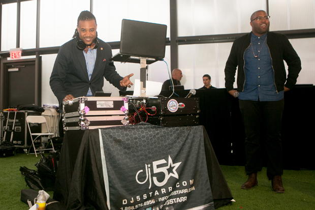 """DJ 5 Starr keeps the crowd of nearly 500 Baltimore residents entertained with music during a free, public screening of the documentary """"STEP"""" at the UA House at Fayette. (Photo courtesy of Bloomberg Philanthropies and Tribeca Film Festival)"""