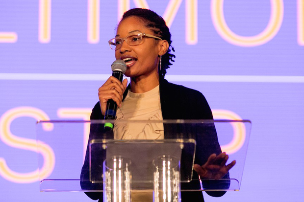 """Jasmine Campbell, the director of UA House at Fayette, welcomes attendees to City Pop-up: Baltimore for a free, public screening of the award-winning documentary, """"STEP."""" (Photo courtesy of Bloomberg Philanthropies and Tribeca Film Festival)"""