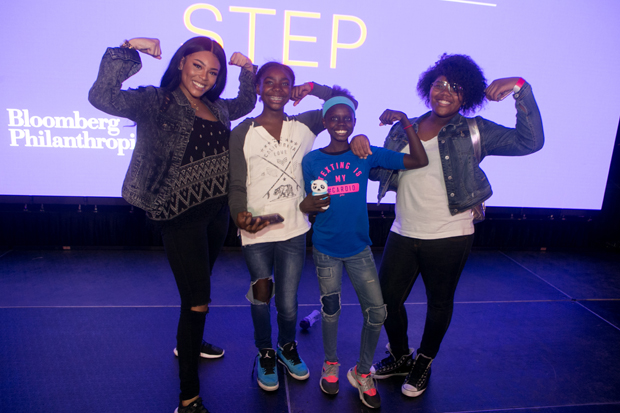 """Blessin Giraldo, far left, who was featured in the documentary """"STEP,"""" has a playful moment with some Baltimore residents who attended the free performance of the award-winning documentary at the UA House at Fayette. (Photo courtesy of Bloomberg Philanthropies and Tribeca Film Festival)"""