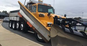 """The State Highway Administration has bought nine new """"quad axle"""" trucks to supplement their standard fleet. These new trucks, pictured here Nov. 8, 2017, in Hanover, Md., can carry more than double the amount of salt and 40 more gallons of fuel (Josh Schmidt/Capital News Service)."""