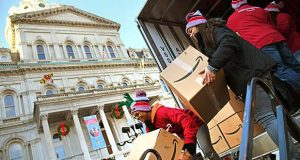 "Amazon backed up its 53-foot Holiday Giving Truck to the front door of Baltimore's City Hall on Thursday and unloaded $15,000 worth of toys for Baltimore City Council President Bernard C. ""Jack"" Young's holiday reception, which benefits the U.S. Marines' Toys for Tots program. Amazon is making a six-state donation tour to benefit organizations in need around their fulfillment centers. (The Daily Record/Maximilian Franz)"
