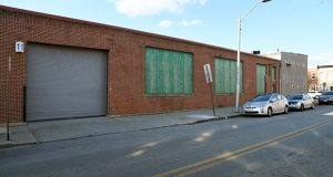 The former Snap Wall warehouse on South Linwood Street in Baltimore's Canton neighborhood would become a five-story apartment building under a proposal approved Thursday by the city's Urban Design and Architecture Review Panel. (Maximilian Franz/The Daily Record)