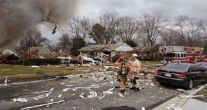 This photo provided by Baltimore County Police & Fire Department shows firefighters at the scene of a house explosion on Tuesday, Dec. 5, 2017 in Woodlawn, Md.  Fire crews are checking all homes on block for damage and dangerous gases. (Baltimore County Police & Fire Department via AP)
