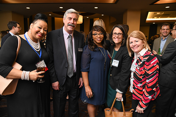 """From left, Roselyn Aker-Black, series psychologist for TVOne's """"For my Woman""""; Thomas Baden Jr., the editor of The Daily Record; Chanel Mason, a senior compensation analyst and assistant vice president at Legg Mason; Meggan Saulo, the managing director and head of global total rewards at Legg Mason; and Patricia Lattin, executive vice president and chief human resources officer at Legg Mason, take time for a photo during The Daily Record's 2018 Leading Women awards ceremony at The Westin Annapolis."""