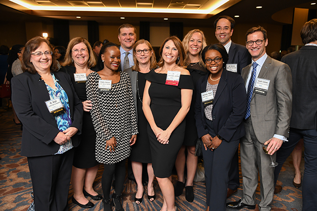 Colleagues, friends and family members congratulate 2018 Leading Women winner Jennifer Boyle, center, the director of client advisory services with CareFirst BlueCross BlueShield, during the awards ceremony at The Westin Annapolis.