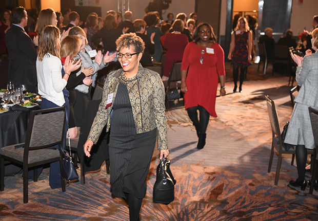Kadija Hart, the director of resource development with Belair-Edison Neighborhoods Inc., participates in a procession of The Daily Record's 2018 Leading Women winners during the awards ceremony at The Annapolis Westin.