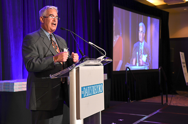 Jeffrey Dubnow, the vice president of development and communications with Chimes International Ltd., delivers an address to the crowd attending The Daily Record's 2018 Leading Women awards ceremony at The Annapolis Westin.