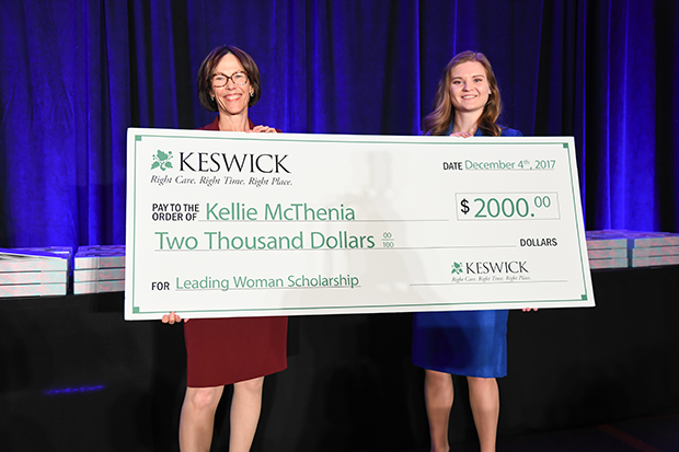 Carmel Roques, left, the CEO of Keswick Multi-Care Center, presents a $2,000 scholarship check to Kellie McThenia, a senior at Towson University, during The Daily Record's 2018 Leading Women awards ceremony at The Annapolis Westin.