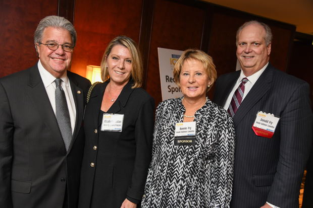2017 Daily Record Icon Honors winners Robert Caret, far left, chancellor of the University of Maryland System; and Donald C. Fry, far right, the president and CEO of the Greater Baltimore Committee, enjoy the awards reception with their wives, Elizabeth Zoltan and Bonnie Fry. (Photo by Maximilian Franz)