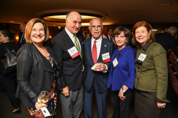 From left, Robin Shaivitz, vice president and senior government relations adviser with Alexander & Cleaver P.A.; Mike Gill, the Maryland commerce secretary and a 2017 Daily Record Icon Honors winner; Henry Rosenberg, chair of the board of Rosemore Inc. and also an Icon Honors winner; Dorothy Rosenberg; and Ruth Lenrow, vice chair at Goucher College, take time for a photo during the awards reception. (Photo by Maximilian Franz)