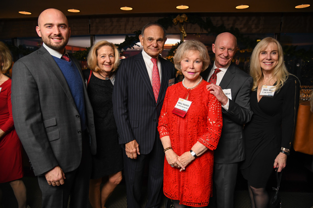 Nancy Grasmick, center, a presidential scholar at Towson University and co-director of The Kennedy Krieger Institute, celebrated her 2017 Daily Record Icon Honors award with Josh Grasmick; Leslie Wilson; Edward St. John, founder and president of St. John Properties Inc.; Courtney Wilson, executive director of the B&O Railroad Museum; and Sharon Akers, vice president of corporate relations with St. John Properties and executive director of the Edward St. John Foundation. Towson University was a reception sponsor for the event. (Photo by Maximilian Franz)