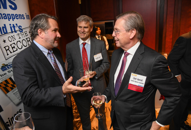 From left, Michael Sullivan, senior director at CareFirst BlueCross BlueShield; and Randolph Sergent, vice president and deputy counsel with CareFirst; enjoy a conversation with CareFirst President and CEO Chet Burrell, a 2017 Daily Record Icon Honors winner. (Photo by Maximilian Franz)