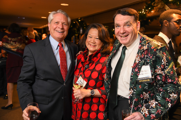 Larry Unger, left, president and CEO of Maryland Public Television and a 2017 Daily Record Icon Honors winner, shares a laugh with Eleanor K. Wang, a Baltimore County physical therapist, freelance actor and a member of the Maryland Public Broadcasting Commission, and David Blumberg, with MPT, during the awards reception at The Center Club. (Photo by Maximilian Franz)